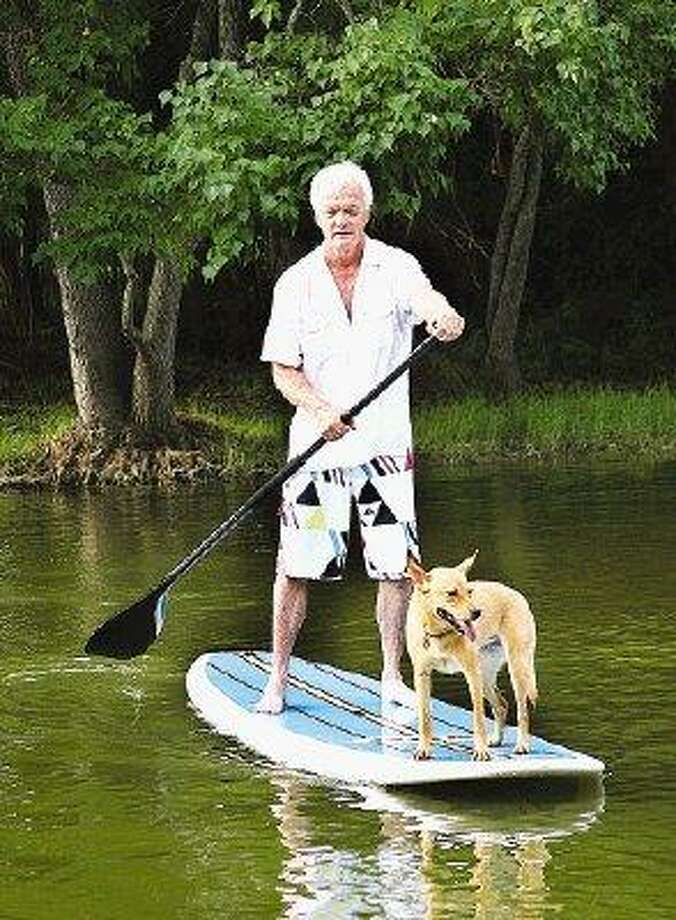 Doug Joslyn is often accompanied by his dog on recreational outings on the lake.
