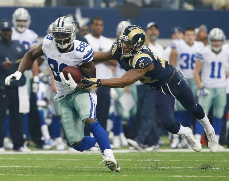Cowboys receiver Dez Bryant breaks away from Rams cornerback Trumaine Johnson. The Cowboys won 31-6. Photo: Jose Yau