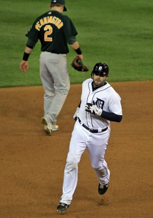 The Detroit Tigers' Alex Avila rounds the bases after a home run in his team's 3-1 victory over Oakland. Photo: Carlos Osorio