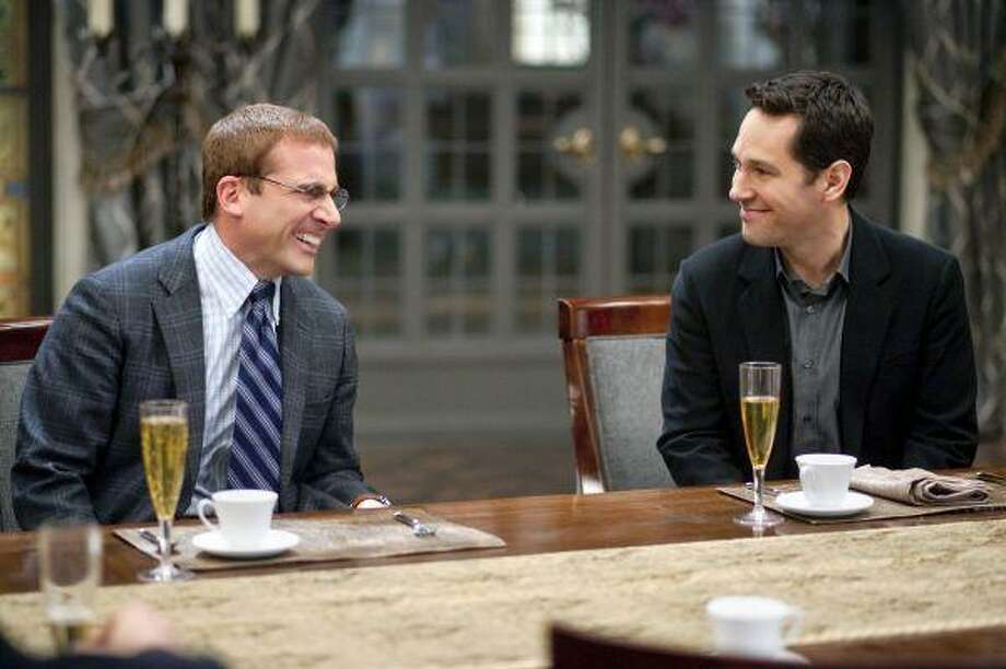 "In this film publicity image released by Paramount Pictures, Steve Carell, left, and Paul Rudd are shown in a scene from ""Dinner for Schmucks."" / Paramount Pictures"