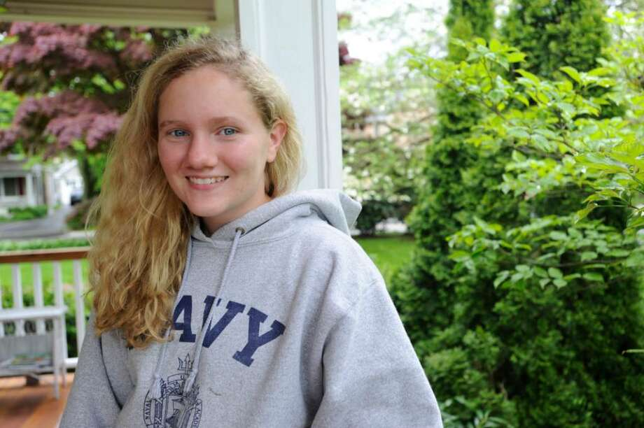 Kristina Byrne, a Greenwich High School senior, who will be attending the U.S. Naval Academy in July, stands on her porch in Old Greenwich on Monday, May 3, 2010. Photo: Helen Neafsey / Greenwich Time