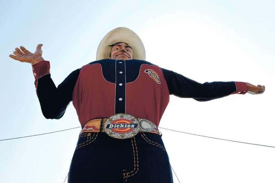 The 52-foot-tall cowboy known as Big Tex is now ready to welcome visitors to the State Fair of Texas after being lifted up to his familiar spot on Monday in Dallas, Tx. Photo: Lara Solt