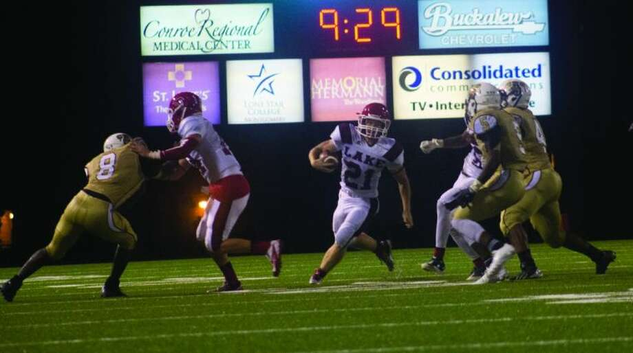 Clear Lake's Nicholas McGee finds a hole in the Conroe defense on Friday night at Buddy Moorhead Memorial Stadium. To view or purchase this photo and others like it, visit HCNpics.com. Photo: Ana Ramirez