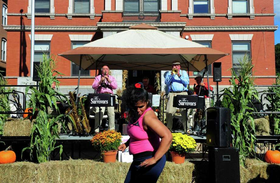 Lydia Rosa, of Ansonia, dances as the The Survivors Swing Band performs during the Harvest Festival in downtown Ansonia, Conn., on Saturday Sept. 23, 2016. Some of the other attractions included a batting cage, an antique fire engine, a visit by Harvey the festival mascott as well as arts and craft and food. Photo: Christian Abraham, Hearst Connecticut Media / Connecticut Post