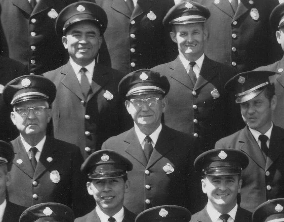 """The firefighter wearing glasses in the center of this part of a larger, panoramic photograph of the San Antonio Fire Department was identified as Ferdinand """"Fred"""" John Burket III by his 105-year-old wife and other family members recently. Photo: E.O. Goldbeck /Courtesy San Antonio Fire Museum"""