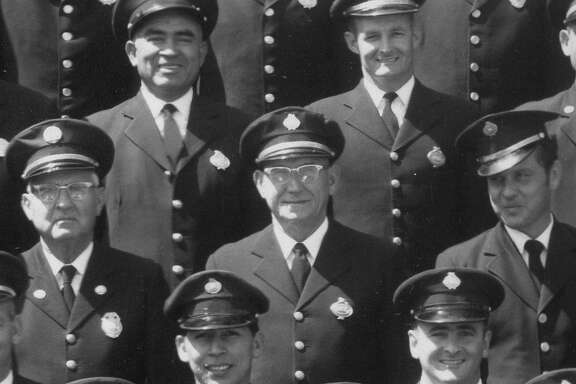 The identity of the firefighter wearing glasses in the center of this part of a larger, panoramic photograph of the San Antonio Fire Department remains a mystery. A former chief has tracked down names for all the rest of the individuals pictured.