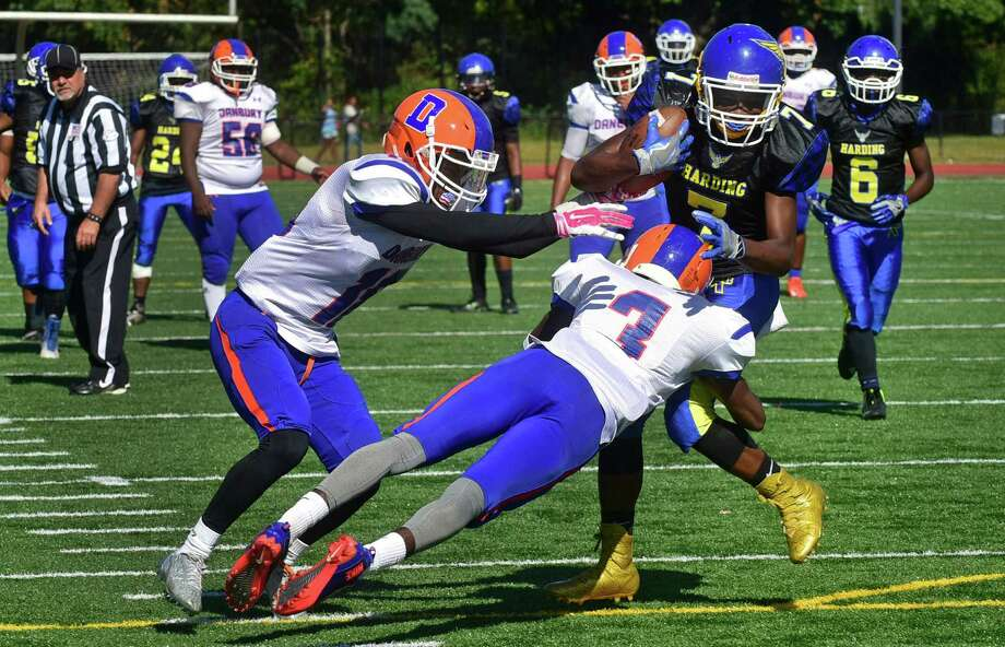 #7 Henery Smalls goes for the endzone after catching a pass as Harding High School takes on Danbury during their FCIAC football game at Kennedy Stadium in Bridgeport, Conn. Saturday, September 24, 2016. Photo: Erik Trautmann / Hearst Connecticut Media / Norwalk Hour