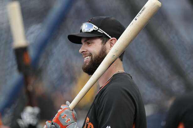 San Francisco Giants first baseman Brandon Belt warms up before the Giants play against the San Diego Padres in a baseball game Thursday, Sept. 22, 2016, in San Diego. (AP Photo/Gregory Bull)