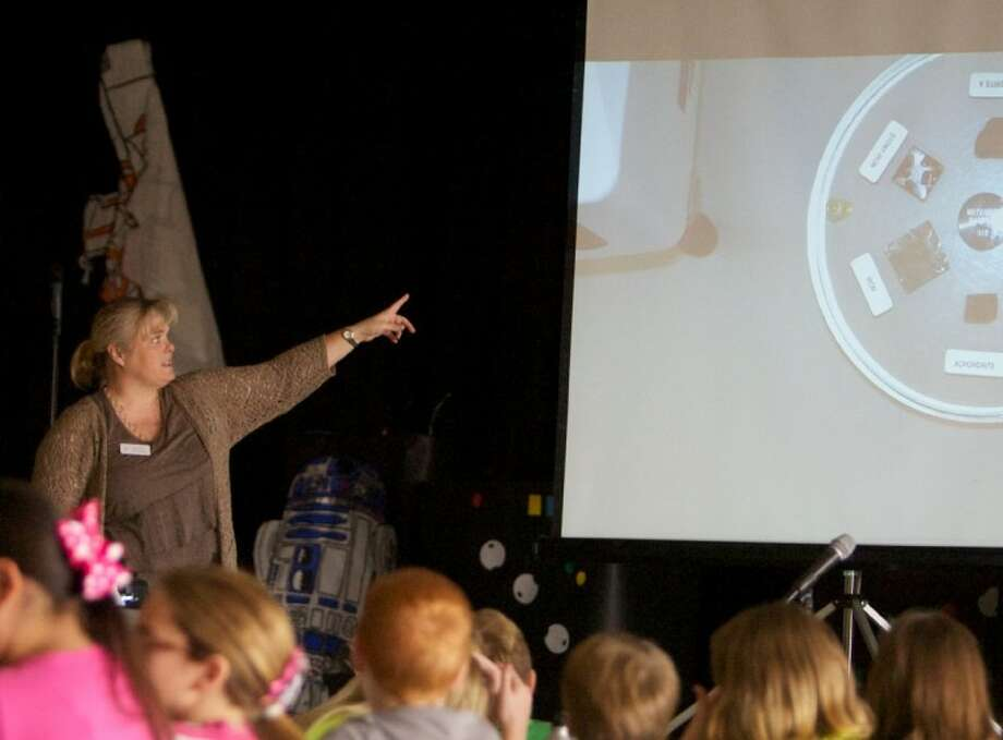 Former NASA employee Dr. Lisa Brown, speaks to Willis ISD students about lunar samples during Saturday's Science Symposium at Hardy Elementary School in Willis. Photo: Staff Photo By Eric Swist