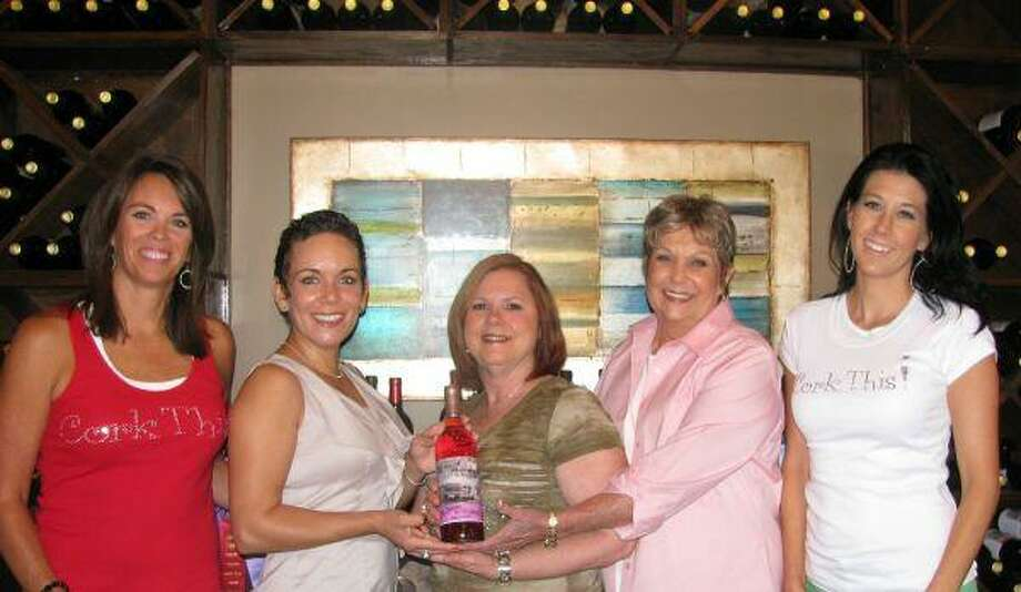 Cork This! Winemaker Karla Nash (left), breast cancer survivors Joy Diaz, Dixie Estep, Susan Donnell and winemaker Fawn Creighton invite guests to attend Uncorking Montgomery County as the inaugural event for the Komen Cure for Breast Cancer in Montgomery County. Cork This! Winery is a women-owned winery in a suburban environment at 21123 Eva St (Texas 105) in Montgomery.