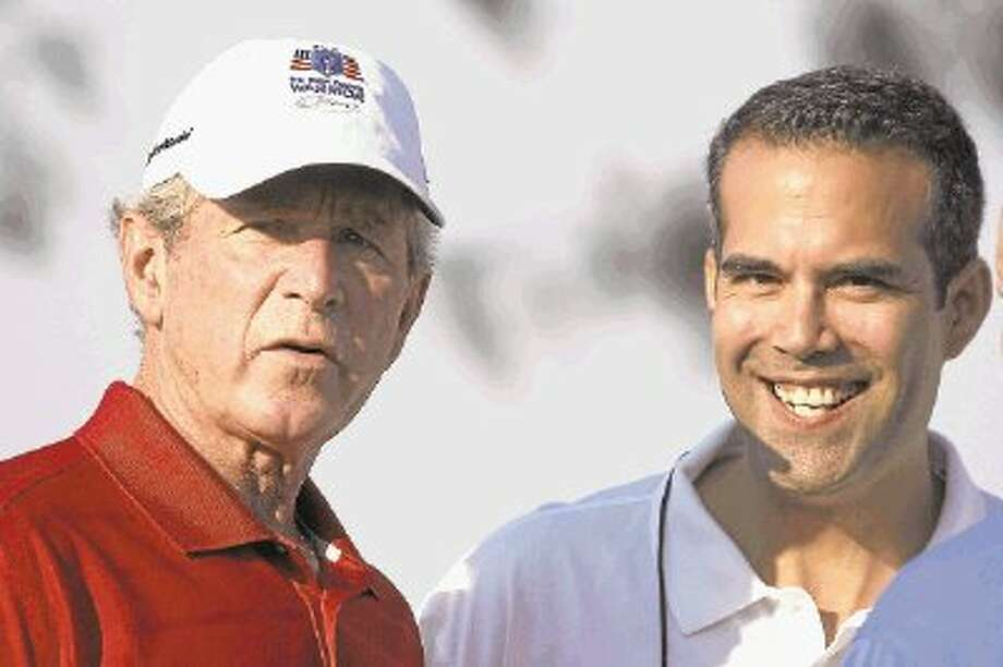 Former President George W. Bush, left, talks with his nephew George P. Bush during the Bush Center Warrior Open in Irving last year. The Warrior Open is a two-day golf tournament featuring members of the U.S. Armed Forces who were severely wounded during the global war against terrorism. Photo: LM Otero / Xtreme Photo FX,LLC2012