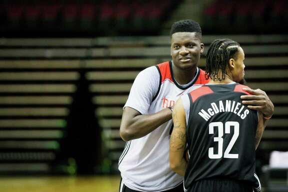Houston Rockets center Clint Capela, left, and guard-forward KJ McDaniels, right, hug after finishing their first day of practice, Saturday, Sept. 24, 2016, in Houston.