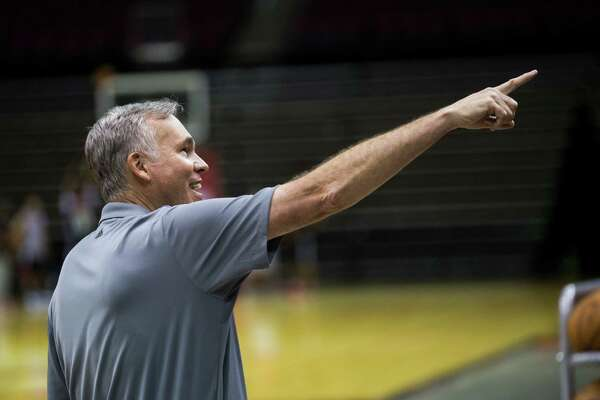 Houston Rockets head coach Mike D'Antoni greets a member of the staff from the basketball court during the first day of practice, Saturday, Sept. 24, 2016, in Houston.