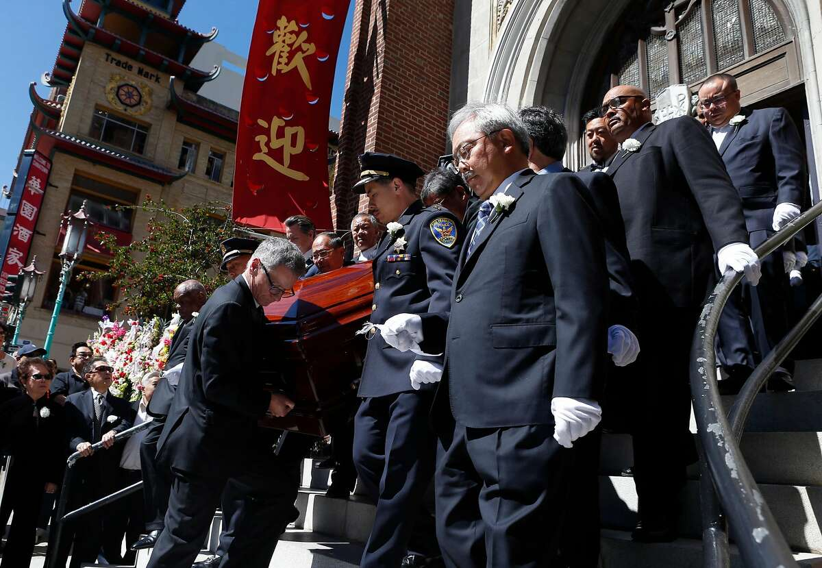 FILE-- Mayor Ed Lee accompanies Rose Pak's casket to a hearse with other dignitaries after funeral services for the Chinatown community leader at Old Saint Mary's Cathedral in San Francisco, Calif. on Saturday, Sept. 24, 2016.