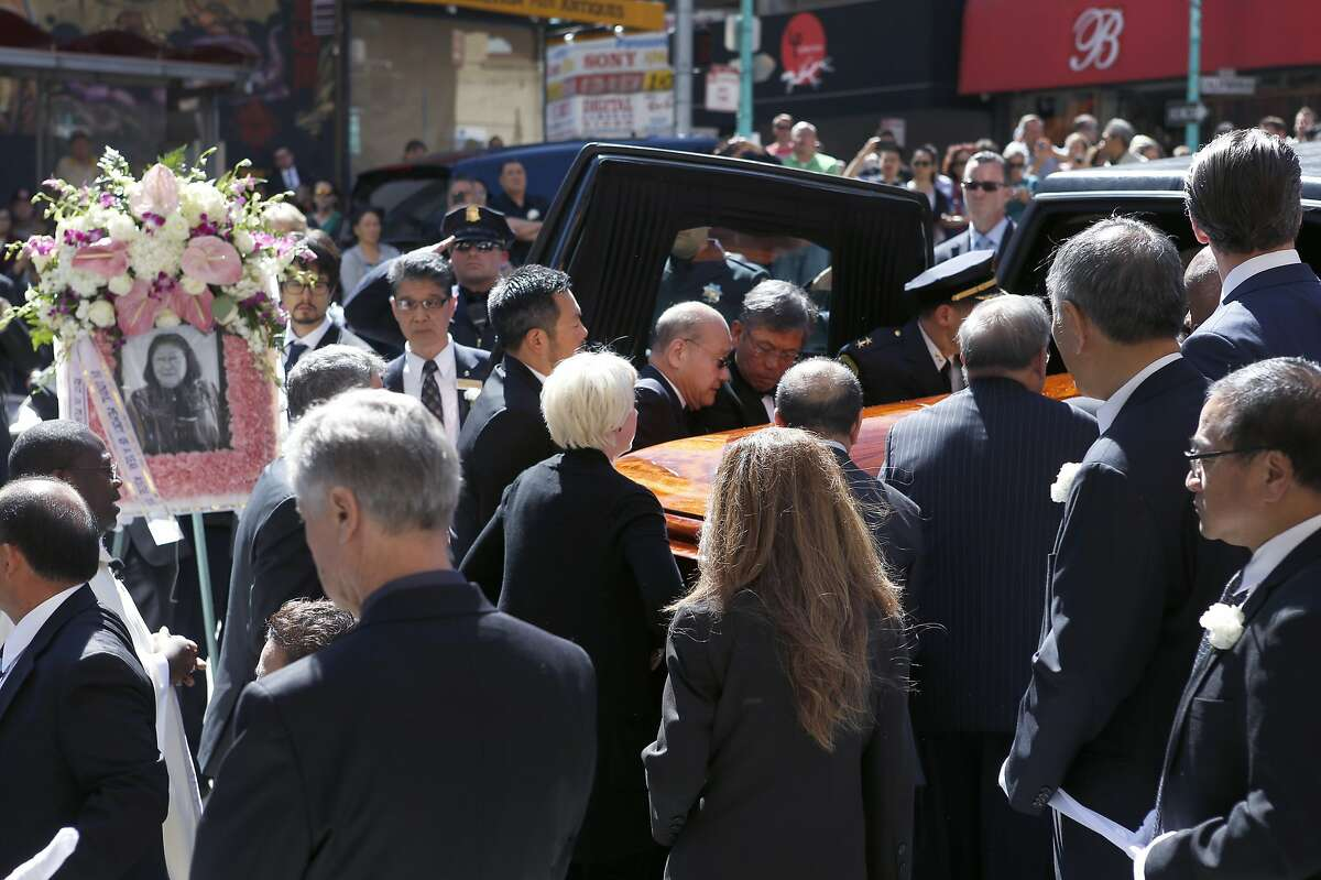 Rose Pak's casket is placed into a hearse after funeral services for the Chinatown community leader at Old Saint Mary's Cathedral in San Francisco, Calif. on Saturday, Sept. 24, 2016.