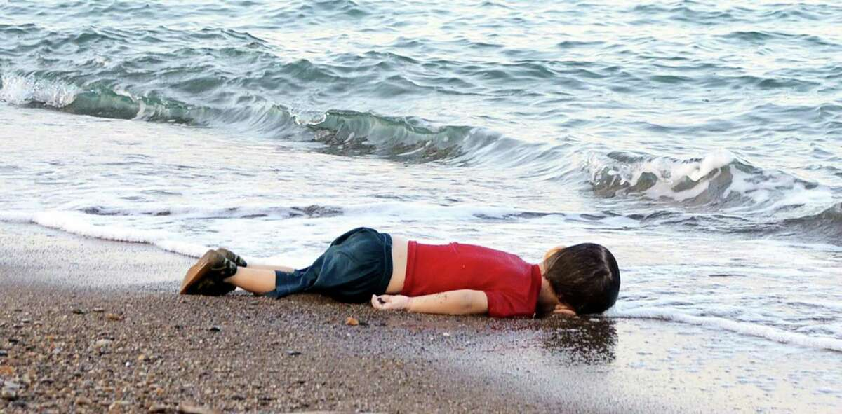 This photo taken Sept. 2, 2015, is of 3-year-old Aylan Kurdi, who died after a boat carrying his family fleeing Syria sank en route to a Greek island. The boy's death sparked a global outcry.