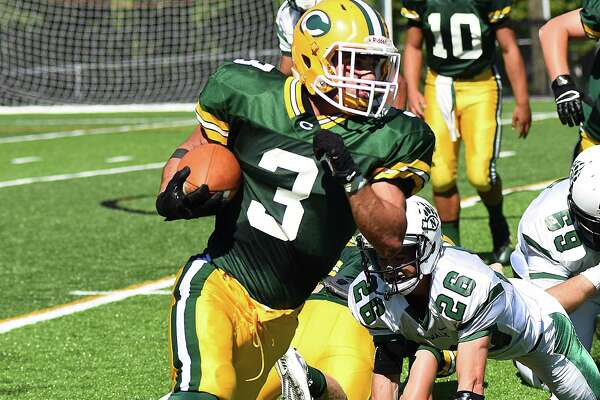Trinity Catholic's Jonmichael Bivona rushed for four touchdowns Saturday, leading the Crusaders to a 52-28 victory over Norwalk on Saturday, the first official day of action on the school's brand new Gaglio Field in Stamford.