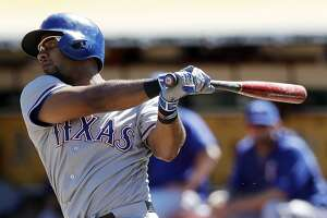 Texas Rangers' Elvis Andrus watches his two-run home run against the Oakland Athletics during the second inning of a baseball game Saturday, Sept. 24, 2016, in Oakland, Calif. (AP Photo/Marcio Jose Sanchez)