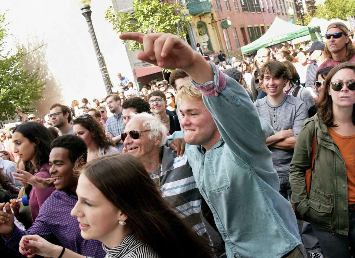 Festival goers cheer as the band Lower Dens performs during the 35th Annual LarkFest, New YorkOs largest one-day street festival, Saturday Sept. 24, 2016 in Albany, NY. (John Carl D'Annibale / Times Union)