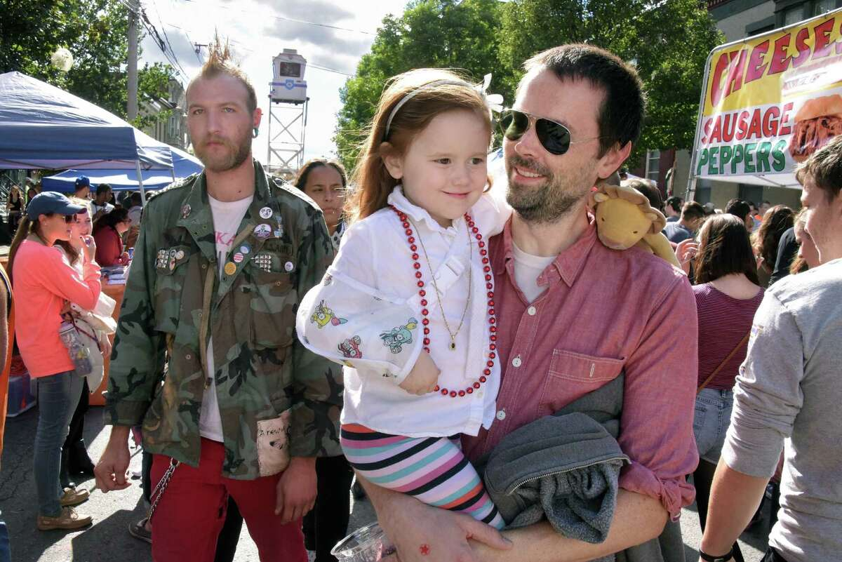 Four-year-old Clara Flynn and her father Brendan Flynn of Albany make their way through the crowds during the 35th Annual LarkFest, New YorkOs largest one-day street festival, Saturday Sept. 24, 2016 in Albany, NY. (John Carl D'Annibale / Times Union)