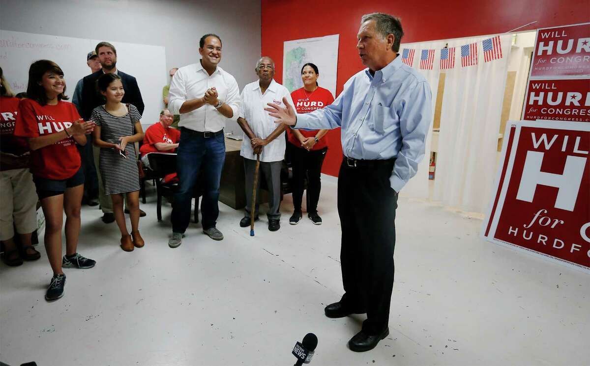 Ohio Gov. John Kasich stops by the campaign headquarters of U.S. Rep. Will Hurd on Saturday. where he continued to distance himself from GOP presidential nominee Donald Trump.