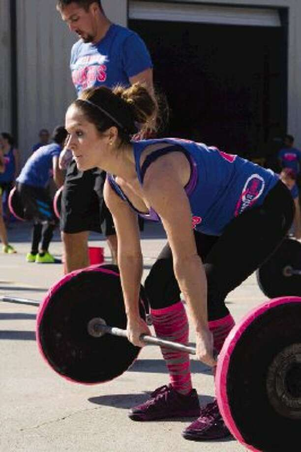 Athletes pump iron to help fight breast cancer - The Courier