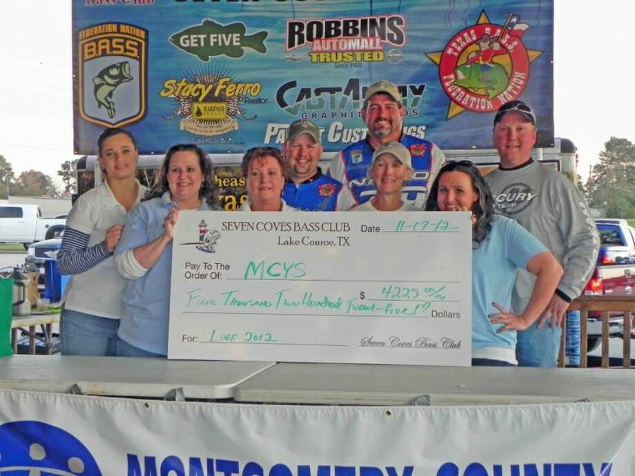 Members of the Seven Coves Bass Club and Montgomery County Youth Services pose with a $4,225 check donated to MCYS. Pictured from left to right are Stacy Glezman of SCBC, Laurie Oliver of MCYS, Robin Stokely of SCBC, Derek Taylor of SCBC, David Glezman of SCBC, Gwen Reed of SCBC, Jenni Teague of MCYS and Ricky Bishop of SCBC.