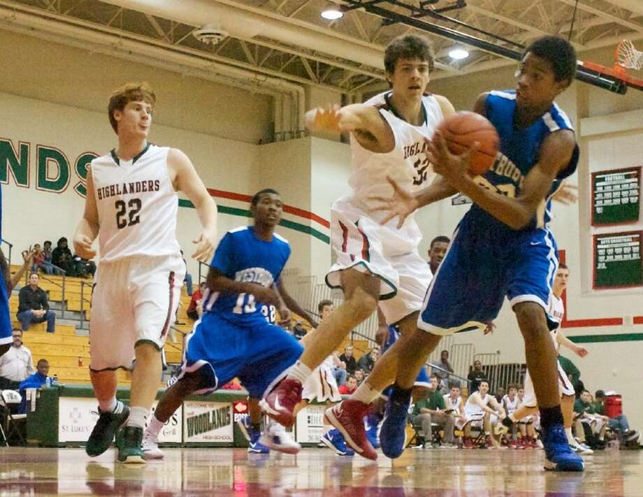 The Woodlands' Clay Fisher battles against Westbury's Julius Reed during Friday's Thanksgiving Tournament game at The Woodlands High School.