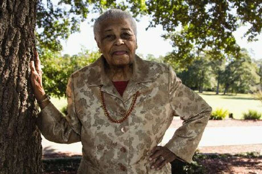Lucille Bradley poses by a tree at the River Plantation Country Club in Conroe for 100th birthday portrait. Bradley died Sunday. Funeral services will be Saturday. Photo: Staff Photo By Ana Ramirez / The Conroe Courier