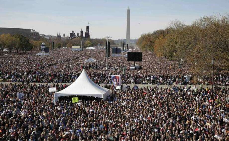 "Thousands participate in the Rally to Restore Sanity and/or Fear on the National Mall in Washington, Saturday. The ""sanity"" rally blending laughs and political activism drew thousands to the National Mall Saturday as the comedians Jon Stewart and Stephen Colbert cast themselves as the unlikely maestros of moderation and civility in polarized times. / AP"