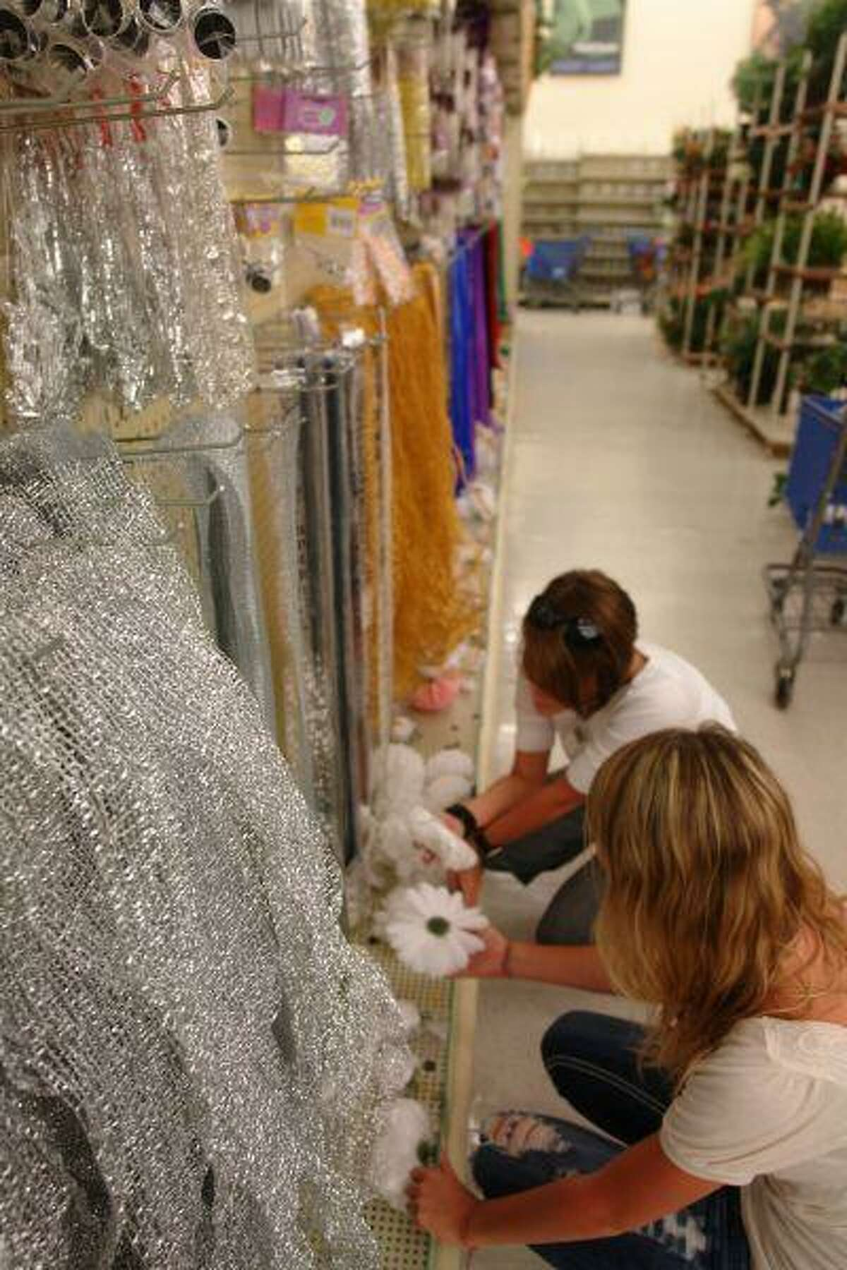 Donna Danes and her daughter Dashley Williams, a Willis High School junior, shop the homecoming aisle at Hobby Lobby looking for the perfect mum flower and trinkets for a homemade mum.