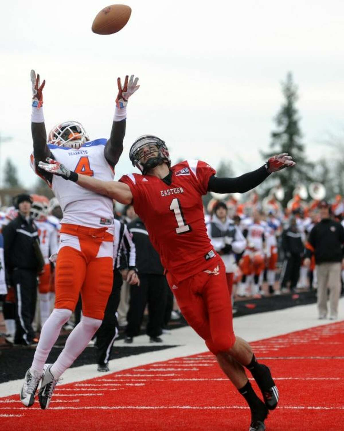 Sam Houston State cornerback Bookie Sneed breaks up a pass for Eastern Washington receiver Brandon Kaufman during the first half of an FCS semifinal playoff game on Dec. 15, 2012, in Cheney, Wash. The Bearkats won, 45-42.