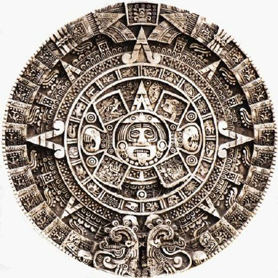 "Mayan calendar conspiracy theorists encourage people not to forget to set their ""end of the world"" calendars to Dec. 21, 2012"