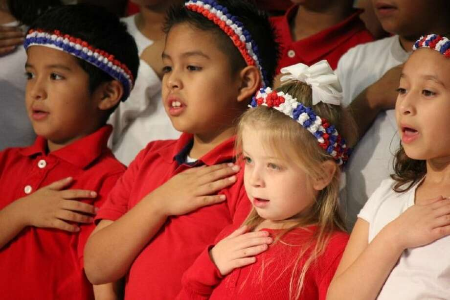 Cannan Elementary third-graders recited the Pledge of Allegiance as part of their Veteran's Day salute. Students, led by music teacher Jodi Christie, sang patriotic songs and other melodies recognizing the different branches of the military. Third-grade teacher Marie Rogers had a special performance on the trumpet.