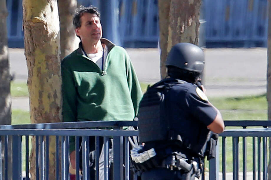 San Francisco Police officers responding to a man with a gun, (pictured) in Civic Center Plaza in San Francisco, California on Sat. Sept. 24, 2016. Photo: Michael Macor / ONLINE_YES