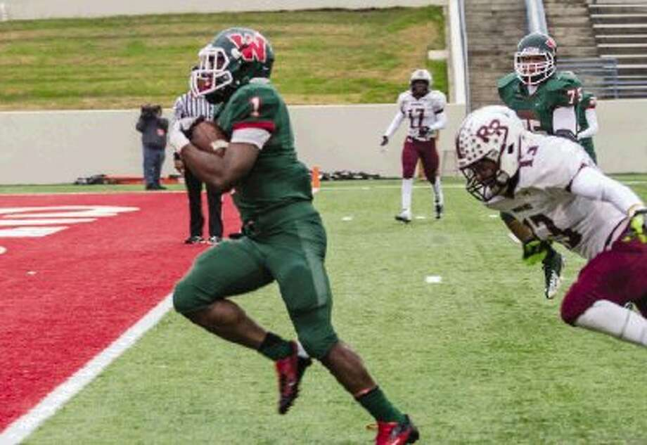 The Woodlands running back Patrick Carr scores against Round Rock in the Class 5A area-round playoffs. The Highlanders face No. 1-ranked Allen on Saturday in Waco. Photo: Staff Photo By Ana Ramirez / The Conroe Courier/ The Woodland