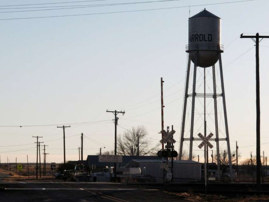 In Monday, Dec. 17, 2012 photo, the town's water tower rises above the railroad tracks in Harrold, Texas. The rural town's lone school has a policy allowing teachers and other employees to carry concealed weapons on campus. Some lawmakers in at least five other states are looking into similar legislation in the wake of last week's deadly elementary school shooting in Newton, Conn. Anti-gun groups oppose the measure. Photo: Angela K. Brown