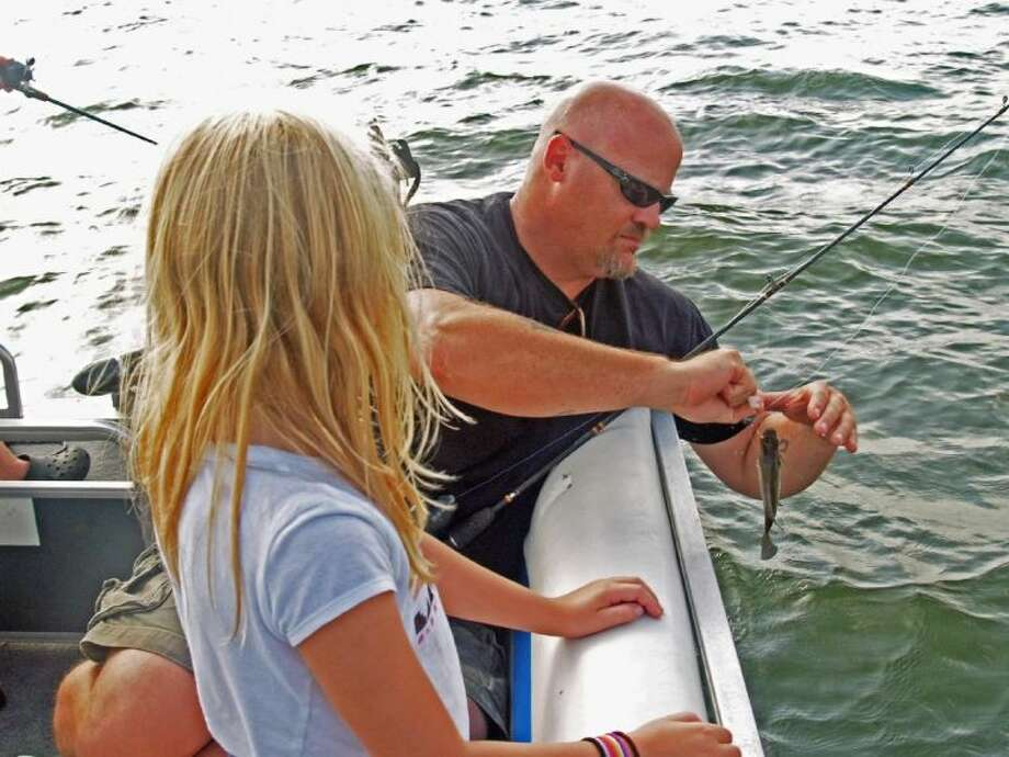 There isn't much to compare with a father showing his daughter how to take the fish she caught off of a hook.