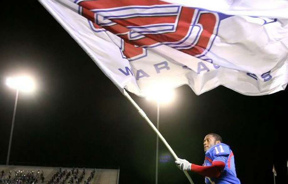 Oak Ridge's Armontre Sneed waves the War Eagle flag as he celebrates Thursday night's 21-20 victory over Kingwood at Woodforest Bank Stadium in Shenandoah. To purchase this photo or others like it, visit http://hcnonline.mycapture.com. / The Courier