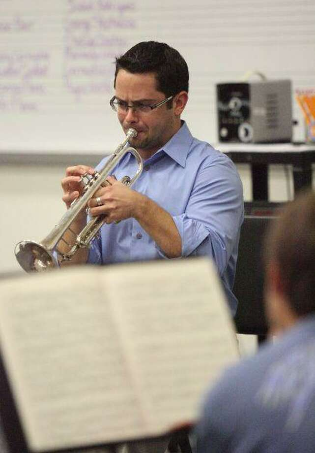 Anthony Prisk, the Houston Symphony's second trumpet, demonstrates a technique for students during the Cynthia Woods Mitchell Pavilion's Music in Motion educational outreach event Saturday at Oak Ridge High School. The event, which included approximately 160 Conroe Independent School District students, helped prepare students for the upcoming All-State Band competition. / The Courier