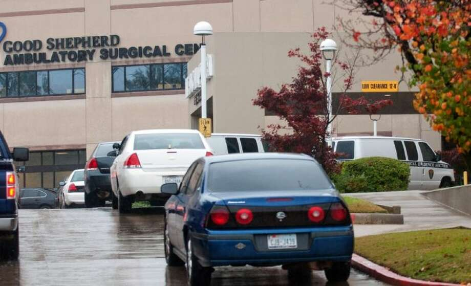Longview Police Department detective units and two physical evidence section vans sit outside Good Shepherd Ambulatory Surgical Center after a stabbing Tuesday in Longview. A nurse died and four people were injured. Photo: Kevin Green