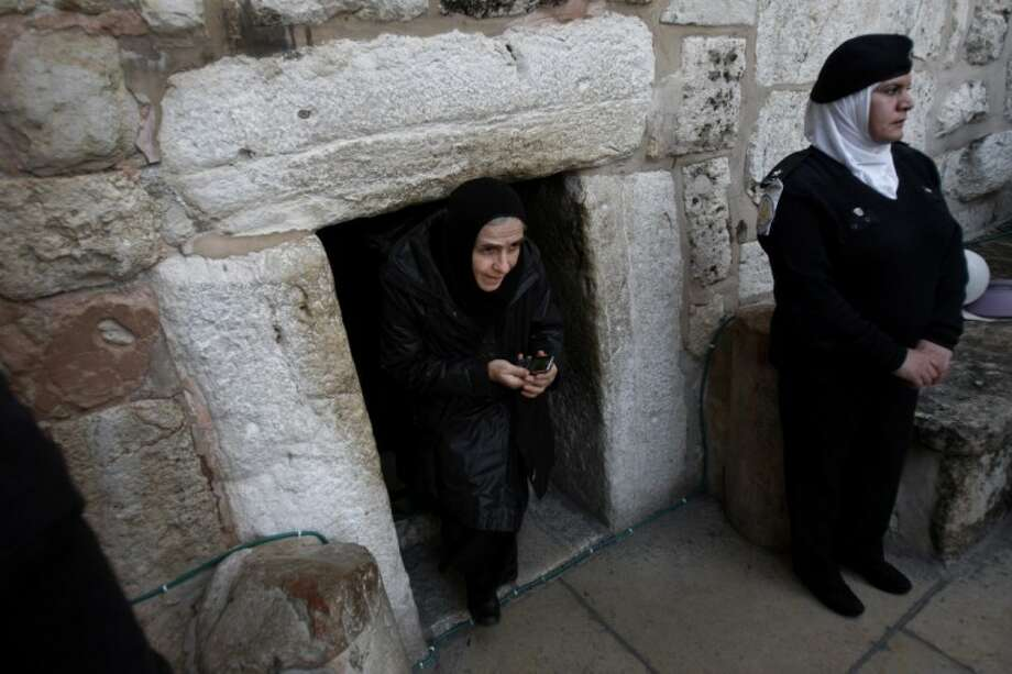 A Christian worshiper walks out of the Church of Nativity, traditionally believed by Christians to be the birthplace of Jesus Christ, in the West Bank town of Bethlehem, Monday, Dec. 24, 2012. Thousands of Christian worshippers and tourists arrived in Bethlehem on Monday to mark Christmas at the site where many believe Jesus Christ was born. Photo: Adel Hana