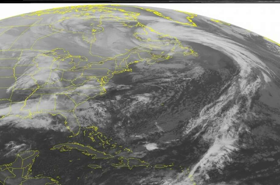 This NOAA satellite image taken Monday, Dec. 24, 2012 at 01:45 AM EST shows a low pressure system over eastern Canada with a cold front stretching across the central Atlantic Ocean. A low pressure system is moving across the Mississippi Valley into the southeastern United States with areas of rain and scattered thunderstorms. Father north, snow showers are seen over the Mid-West. Photo: FRE