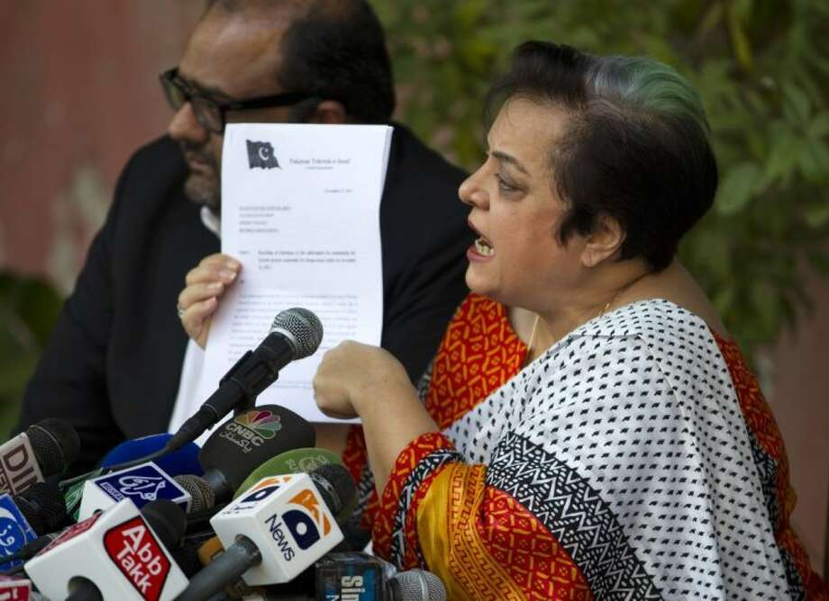 Shireen Mazari, information secretary of the Pakistan Tehreek-e-Insaf party, shows a document during a news conference in Islamabad, Pakistan on Wednesday. A political party opposed to U.S. drone attacks in Pakistan revealed what it said was the name of the top CIA spy in the country on Wednesday and called for him and the head of the agency to be tried for a recent missile strike. Pakistani police and intelligence officials have said the attack on an Islamic seminary in Khyber Pakhtunkhwa's Hangu district on Nov. 21 killed five people. Photo: B.K. Bangash