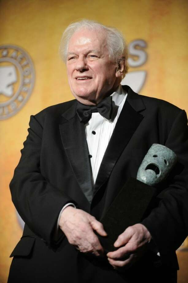 In this Jan. 27, 2008 photo, Charles Durning holds his life achievement award at the 14th Annual Screen Actors Guild Awards in Los Angeles. Durning, the two-time Oscar nominee who was dubbed the king of the character actors for his skill in playing everything from a Nazi colonel to the pope, died Monday at his home in New York City. He was 89. Photo: Chris Pizzello