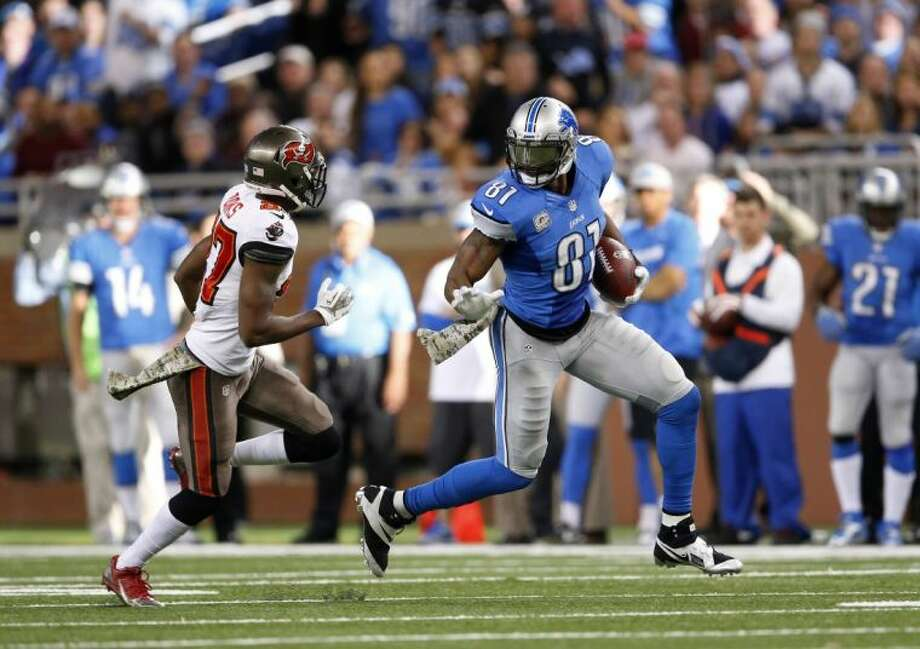 Detroit Lions wide receiver Calvin Johnson runs for yards after a catch against the Tampa Bay Buccaneers on Sunday in Detroit. Photo: Paul Sancya