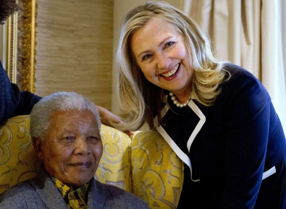 In this Aug. 6, 2012 file photo, U.S. Secretary of State Hillary Rodham Clinton, right, meets with former South Africa President Nelson Mandela, 94, at his home in Qunu, South Africa. Photo: Jacquelyn Martin