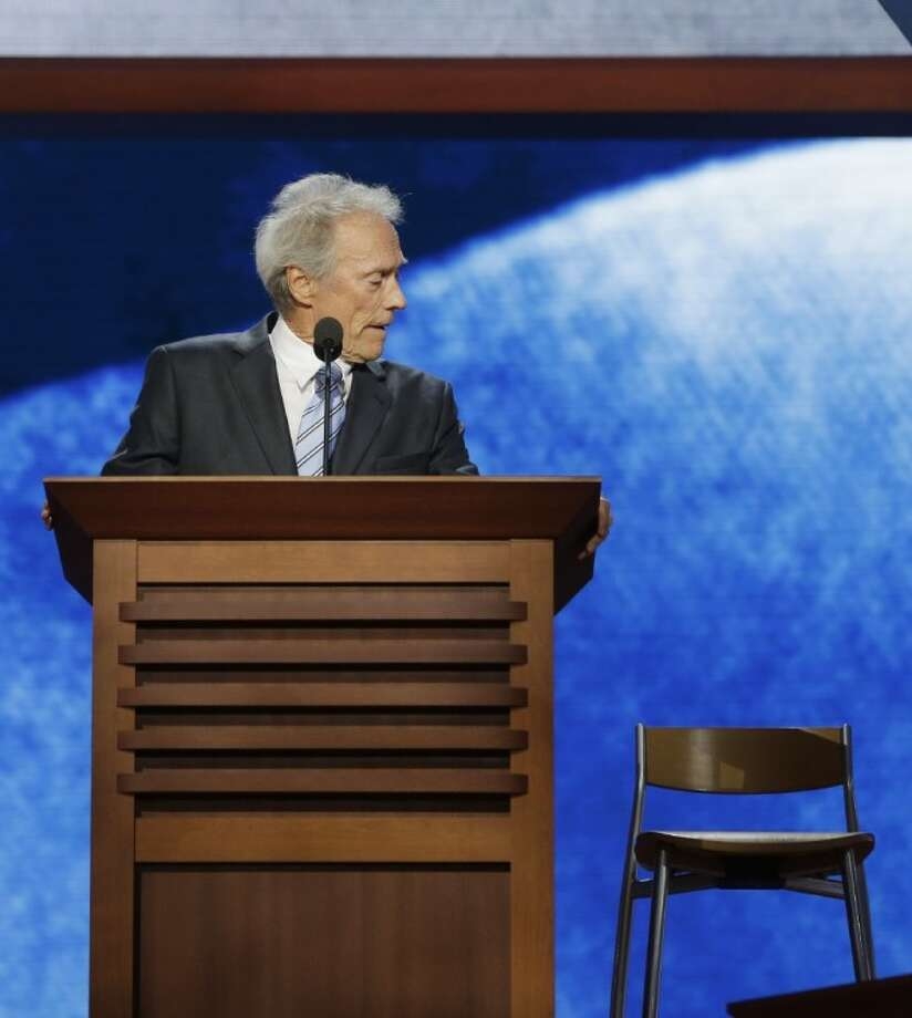 This Aug. 30, 2012 file photo shows actor Clint Eastwood looking toward an empty chair as he addresses the Republican National Convention in Tampa, Fla. Photo: Charles Dharapak