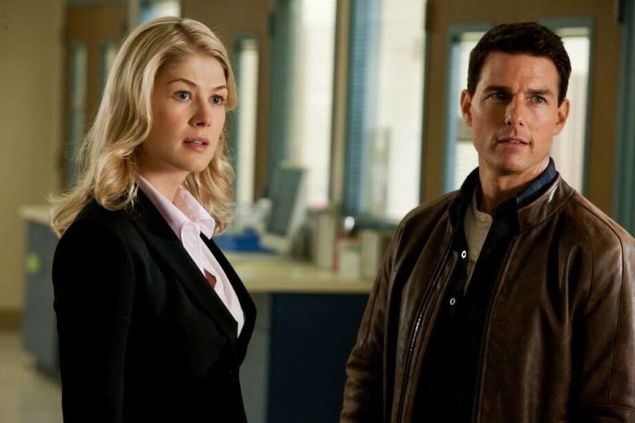 "This undated publicity photo released by Paramount Pictures shows, from left, Rosamund Pike as Helen, and Tom Cruise as Reacher, in the film, ""Jack Reacher."" Photo: Karen Ballard"