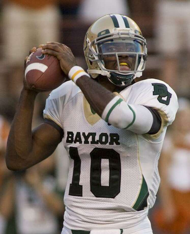 Baylor quarterback Robert Griffin III looks toward his receivers during first-quarter action in the Bears' game against Texas, Saturday in Austin. / FR170210 AP